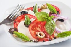 Caprese salad with mozzarella, tomato and basil Stock Photos