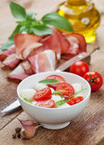 Caprese salad with mozzarella, tomato, basil on white plate Royalty Free Stock Image
