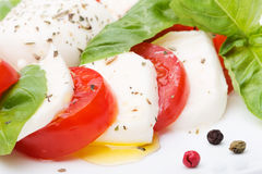 Caprese salad. Mozzarella, tomatoes and basil leaves Stock Photography