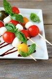 Caprese Salad On Wooden Sticks Royalty Free Stock Photos