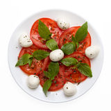 Caprese salad on plate directly above. Isolated on white background Royalty Free Stock Photo