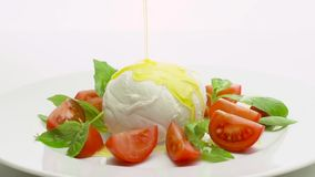 Caprese salad with pouring olive oil stock footage