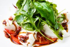 Caprese salad with ruccola Royalty Free Stock Photo