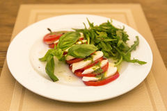 Caprese Salad - salad with tomato, mozzarella cheese and pesto s Royalty Free Stock Photography