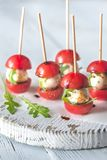 Caprese salad skewer appetizers. On the wooden board Royalty Free Stock Photo