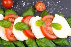 Caprese salad on slate Royalty Free Stock Photography