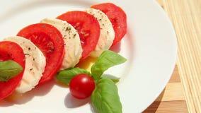Caprese salad, slices of tomato mozzarella basil stock video footage