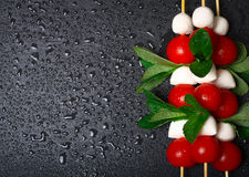 Caprese salad on sticks stock image