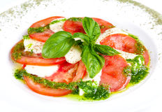 Caprese salad. Tasty and beautiful Caprese salad on the plate Stock Photos