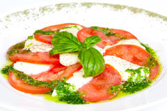 Caprese salad. Tasty and beautiful Caprese salad on the plate Stock Images