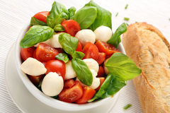 Caprese salad. Tomato and mozzarella with basil Stock Image