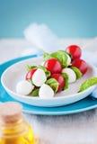 Caprese salad. Tomato mozzarella sticks Stock Photos