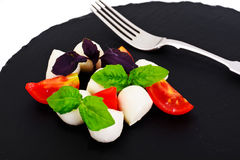 Caprese salad of tomatoes, basil, mozzarella, pepper. Studio Photo Stock Photography
