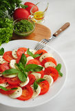 Caprese salad with tomatoes, mozarella cheese and basil Stock Images
