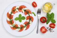 Caprese salad with tomatoes and mozzarella from above on wooden Royalty Free Stock Photos