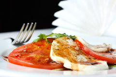 Caprese salad - tomatoes, mozzarella and arugula Stock Image