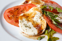 Caprese salad - tomatoes, mozzarella and arugula Stock Photography
