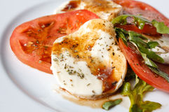 Caprese salad - tomatoes, mozzarella and arugula Royalty Free Stock Image