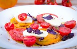 Caprese salad with tomatoes, mozzarella and basil. Royalty Free Stock Photo
