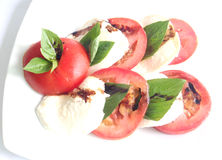 Caprese salad. On white plate Stock Images