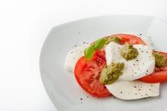Caprese salad on the white square plate horizontal Royalty Free Stock Photos