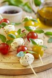 Caprese salad on wooden sticks stock photo