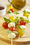 Caprese salad on wooden sticks Royalty Free Stock Images