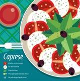 Caprese-Salat auf Platte mit Gabel Stockbild