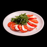 Caprese-Salat auf Schwarzem Lizenzfreie Stockbilder