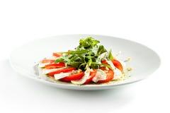 Caprese-Salat mit Rocket Salad Lizenzfreie Stockfotografie
