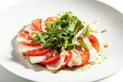 Caprese-Salat mit Rocket Salad Stockfoto