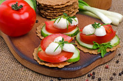 Caprese sandwiches of mozzarella cheese, tomatoes, cucumber and Stock Photo