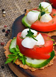 Caprese sandwiches of mozzarella cheese, tomatoes, cucumber and Stock Images