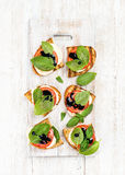 Caprese sandwiches with tomato, mozzarella cheese, basil and balsamic glaze on white painted wooden background Stock Photography