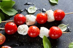 Mozzarella and cherry tomatoes on skewers royalty free stock photo