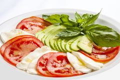 Caprese on a white plate royalty free stock images