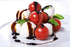 Caprese with whole tomatoes Royalty Free Stock Photo