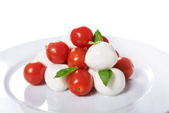 Caprese with whole tomatoes Royalty Free Stock Photos