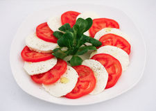 Capresse salad. With fresh basil and olive oil Royalty Free Stock Image