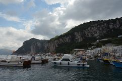 Capri, Anacapri, sea, sky, water, harbor. Capri, Anacapri is sea, harbor and coast. That marvel has sky, cloud and mountain and that beauty contains water, boat stock photo