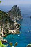 Capri coastline. View of the coastline of the island of Capri, Italy, with one of its seaside rock formations known as the Faraglioni Royalty Free Stock Image