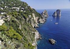 Capri and the Faraglioni. The Island of Capri and the rocks Faraglioni on the Mediterranean blue sea. South of Italy stock image