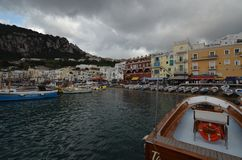 Capri, harbor, water, sky, marina. Capri is harbor, marina and boat. That marvel has water, sea and port and that beauty contains sky, waterway and watercraft. ( stock image
