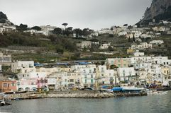 Capri harbour scenic view. Harbour of Capri island by a cloudy day,(part of Campania) in the Bay of Naples in southern Italy, a tourist attraction noted for royalty free stock photos