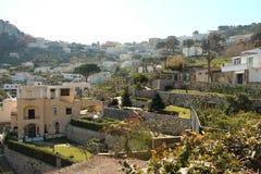 Capri, hill view  Italy. View of village on Capri island. Classic mediterranean arhitecture and vegetation Stock Photos