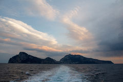 Capri island from boat. View from boat departing Capri in the evening Stock Photos
