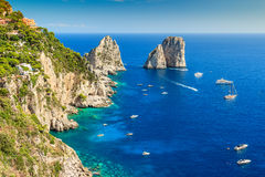 Capri island and Faraglioni cliffs,Italy,Europe. Faraglioni cliffs panorama,and the majestic Tyrrhenian sea,Capri island,Italy,Europe royalty free stock photography
