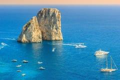 Capri island and Faraglioni cliffs,Italy,Europe. Faraglioni cliffs panorama,and the majestic Tyrrhenian sea,Capri island,Italy,Europe royalty free stock images