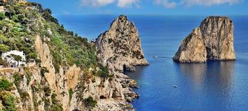 Capri island with Faraglioni cliffs, Italy. Faraglioni cliffs panorama, Capri island Italy royalty free stock photo