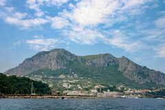 Capri, Italy - A view of the island from the sea. royalty free stock photography